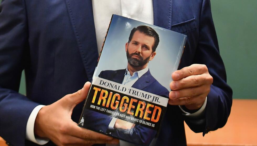 <strong>MISTENKSOMT:</strong> Noen har kjøpt opp store kvanta av Donald Trump Jr. sin nye bok «Triggered». Foto: AFP / NTB Scanpix