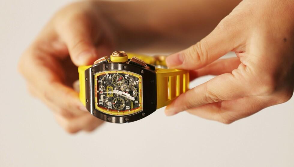 <strong>KOSTBAR:</strong> Richard Mille-klokkene er forbeholdt personer med god råd. Her fra en auksjon i Dubai. foto: Satish Kumar / Reuters / NTB Scanpix