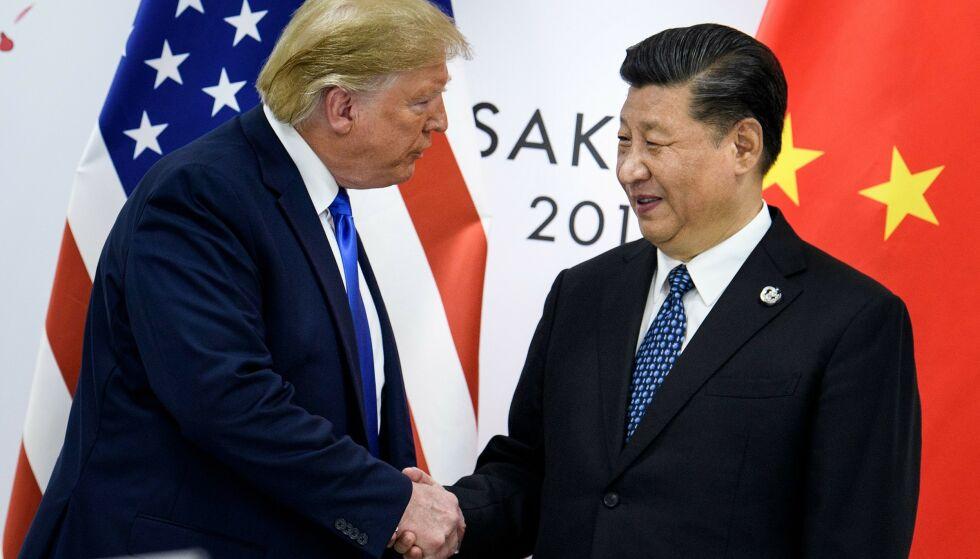 ENIGE: President Donald Trump og president Xi Jinping er enige om første steg i en handelsavtale. Foto: Brendan Smialowski / AFP / NTB scanpix