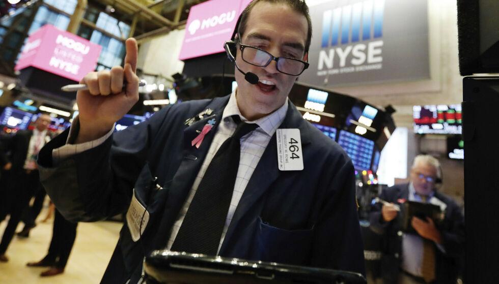 OPPTUR: Ringvirkningene av oppgangen fra Wall Street torsdag merkes i Asia fredag. Illustrasjonsfoto: Richard Drew / AP / NTB Scanpix