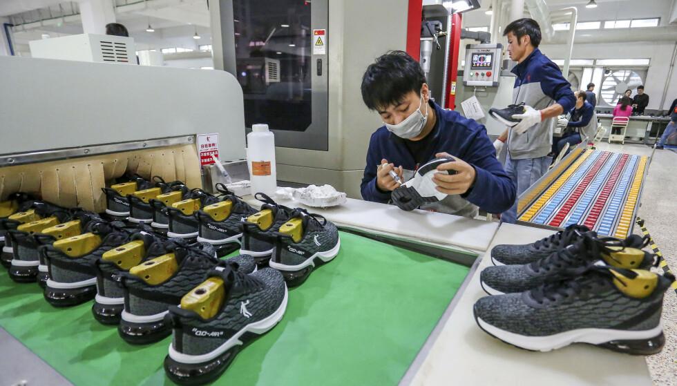 SVAK VEKST: Svakere innenlands etterspørsel og handelskrigen med USA får skylden for at Kina opplever den svakeste økonomiske veksten siden 1990. Foto: Chinatopix via AP / NTB scanpix