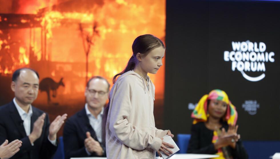 MILJØVERNERE: Den kinesiske miljøverneren Ma Jun, som er direktør ved forskningsinstituttet Institute of Public and Environmental Affairs i Beijing, delte tirsdag scenen med den svenske klimaaktivisten Greta Thunberg. Foto: Michael Probst / AP / NTB Scanpix