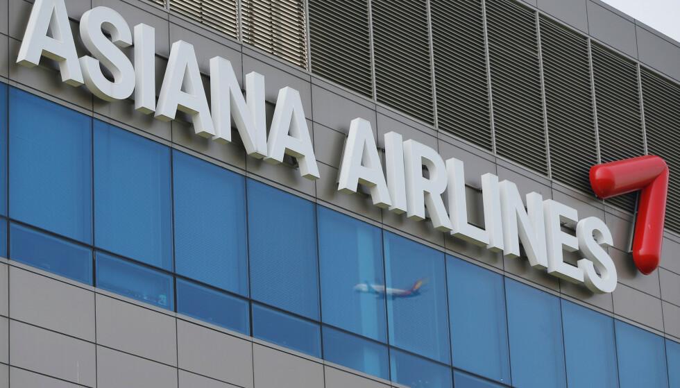 KARANTENE: Tre passasjerer med Astana er satt i karantene. Foto: Kim Hong-Ji / Reuters / NTB Scanpix