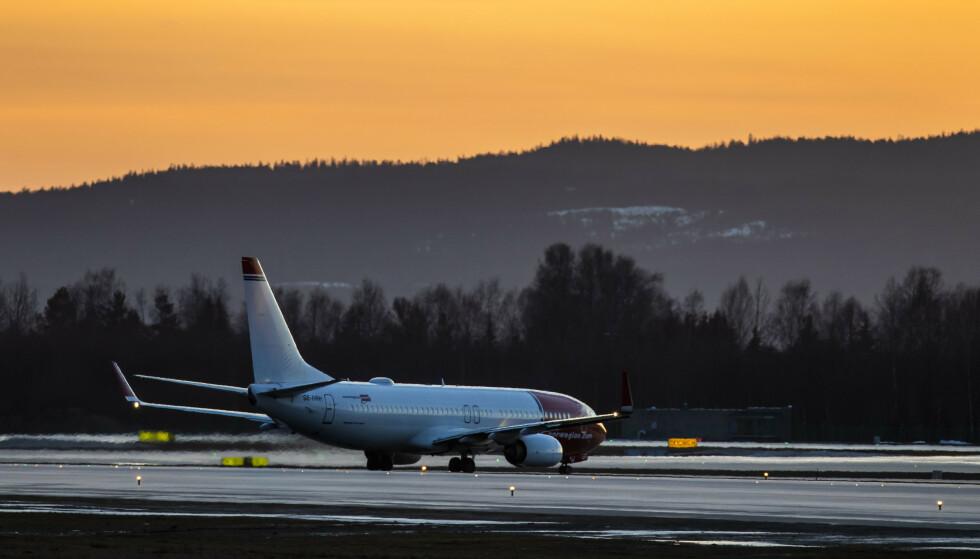 FALLER: Norwegian-aksjen faller fra start, og svinger kraftig i åpningsminuttene etter nyheten om færre passasjerer i februar og kanselleringer som følge av laverer etterspørsel. Foto: Håkon Mosvold Larsen / NTB scanpix
