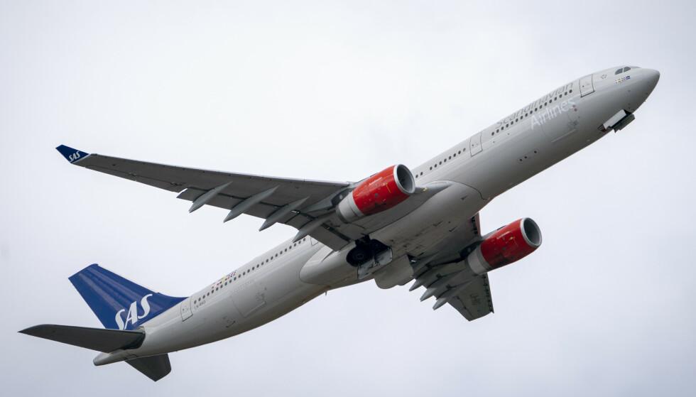 <strong>INNSTILLER:</strong> SAS innstiller 2000 flyvninger i mars. Foto: Heiko Junge / NTB scanpix
