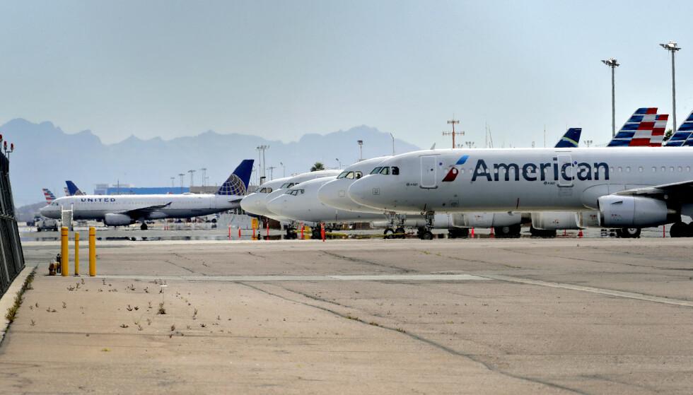 HISTORISK PAKKE: Den amerikanske staten og flyselskapene har blitt enige om detaljene i en krisepakke på 25 milliarder dollar. Foto: Matt York / AP / NTB scanpix