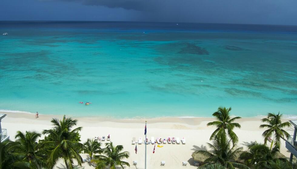 <strong>IDYLLISK:</strong> Cayman er kjent som et av verdens mange finanssentrum og ligger i Det karibiske hav, ikke langt fra Cuba og Jamaica. Staten defineres som et britisk oversjøisk territorium. Foto: NTB Scanpix