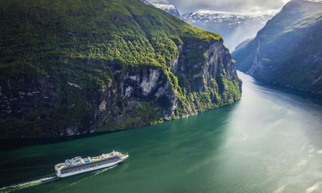 <strong>DYSTERT:</strong> Hvert år farter flere hundre tusen turister til Geiranger - der et stort antall ankommer med cruiseskip. Denne sommeren vil bli ganske annerledes. Foto: Halvard Alvik / NTB Scanpix