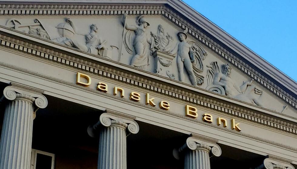 KUTTER: Danske Bank skal kutte opp mot 1600 stillinger i løpet av det neste året. Også i Norge skal det bli færre ansatte. Foto: REUTERS / Jacob Gronholt-Pedersen / NTB scanpix