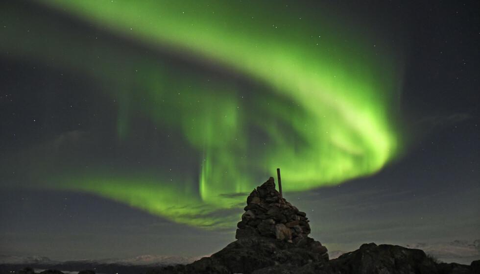 MAGISK: Nordlyset fotografert fra Sørtinden på Kvaløya, ved Tromsø. Foto: Rune Stoltz Bertinussen / NTB