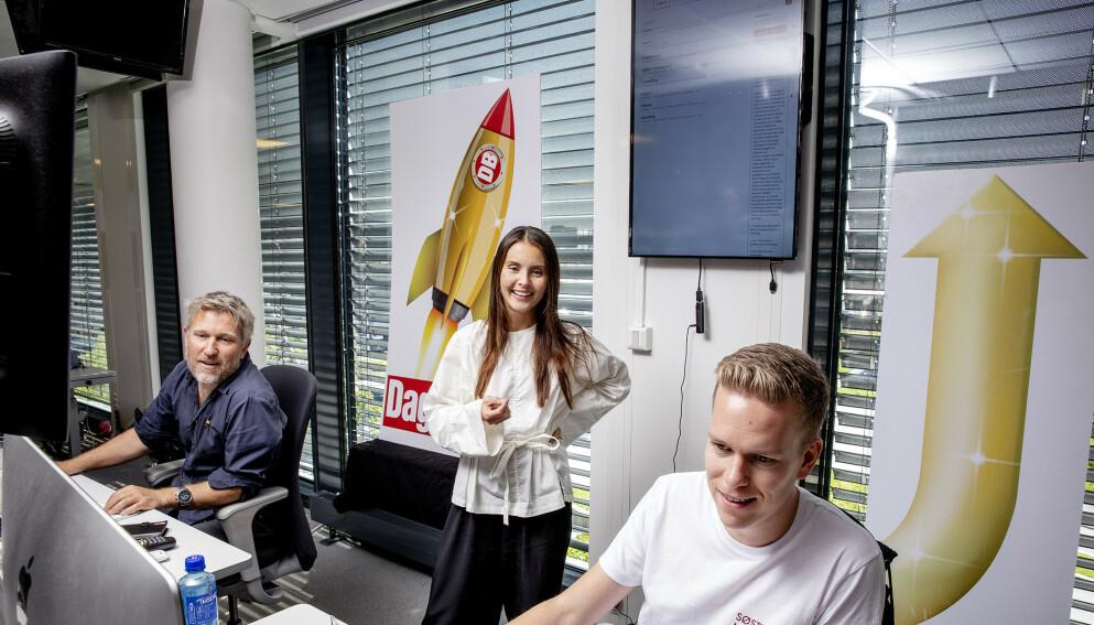 VILL VEKST: Dagbladets redaksjon, her representert ved vaktsjef Thomas Sæbø, redaksjonssjef Hege Varsi og vaktsjef Jesper Nordahl Finsveen, har god grunn til å smile bredt. Foto: Nina Hansen / Dagbladet