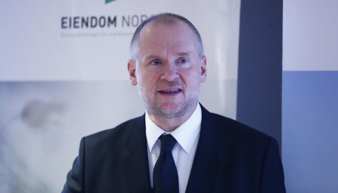 ALARM: Administrerende direktør i Eiendom Norge, Henning Lauridsen, mener boligprisutviklingen i pressområder gir grunn til bekymring. Foto: Terje Pedersen / NTB