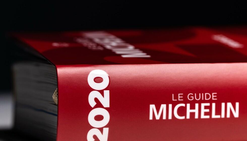 MICHELIN GUIDE: Den anerkjente, respekterte Michelin-guiden i rødt omslag utgis hvert år. Foto: Joel Saget / AFP / NTB
